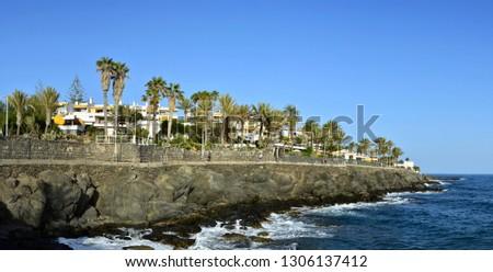 Tourist at the beach promenade by San Augustin at the Canary Isl stock photo © olandsfokus