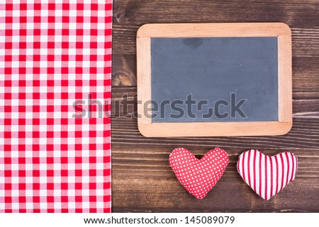 Red checkered tablecloth with hearts on a white wooden backgroun Stock photo © Zerbor