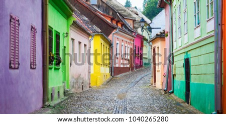 stone paved old street with colored houses from sighisoara fortr stock photo © pixachi