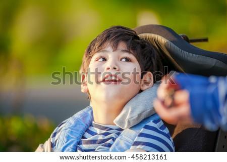 ハンサム 無効になって 少年 車いす 笑みを浮かべて ストックフォト © jarenwicklund