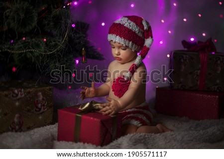 Portrait of a beautiful young girl in winter hat. She bowed her head and folded her arms straight. stock photo © ANessiR