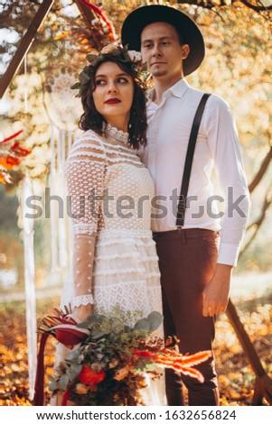brunette · bruid · portret · huwelijksceremonie · boog · bloem - stockfoto © victoria_andreas