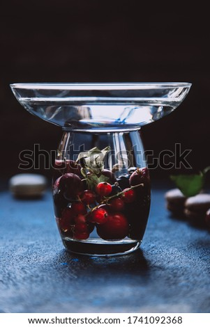 Red currant in glass bowl against black background and thawing c Stock photo © user_11056481