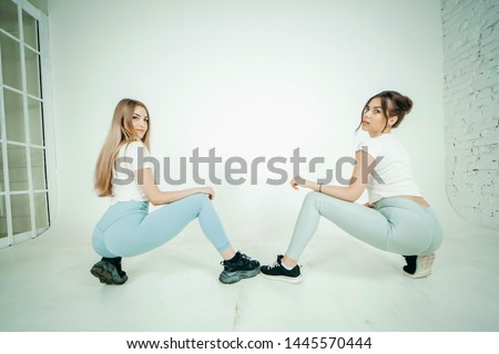 girl dancing twerk in the studio sitting on the floor on a white stock photo © nobilior