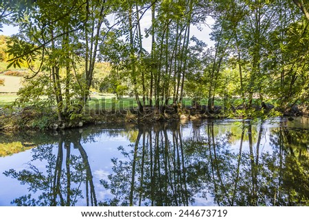 Stock fotó: Tükröződés · fák · folyó · naplemente · természet · háttér