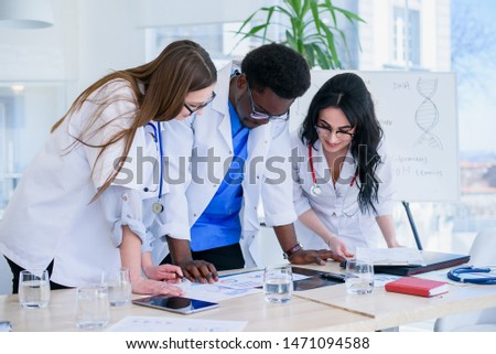 Female doctor presenting medical exam results to patient using t Stock photo © stevanovicigor