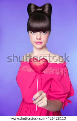 red heart in teen girl hand brunette young model with bow hair stock photo © victoria_andreas