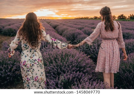 Beautiful young two women over a violet lavender field in Proven Stock photo © Victoria_Andreas