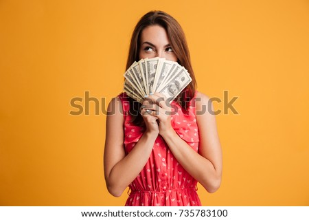 pretty young woman standing and posing with hands behind head stock photo © deandrobot