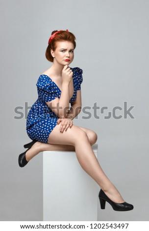 вертикальный изображение довольно недовольный женщину сидят Сток-фото © deandrobot