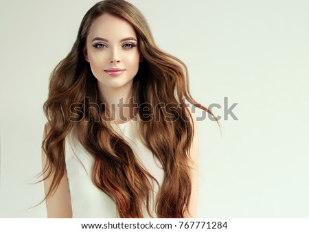 Beauty wavy hair. Pretty brunette girl portrait. Long wavy hairs Stock photo © Victoria_Andreas