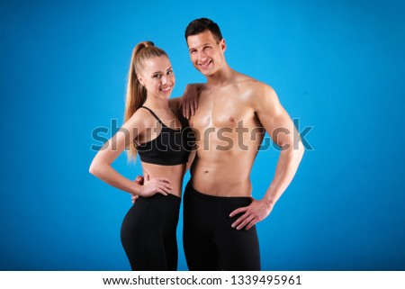 fit young man with beautiful torso and a rope on blue background stock photo © master1305