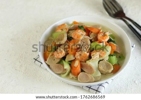 Vegetable cabbage salad and meatballs on plate close up, white background Stock photo © yelenayemchuk