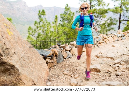Cross country running with backpack in mountains on rocky trail Stock photo © blasbike