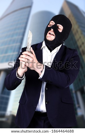 Robbery man. Criminal with knife robbing businessman with suitca Stock photo © popaukropa