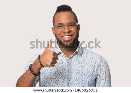 Glad happy african american business man showing thumbs up carto Stock photo © NikoDzhi