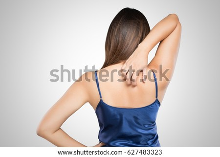 Woman scratching her itchy back with allergy rash, Shoulder, Con Stock photo © eddows_arunothai