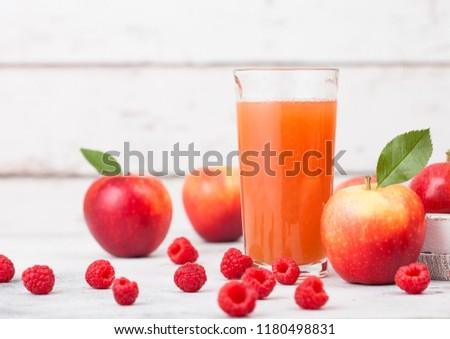 Glass of fresh organic apple juice with pink lady red and granny smith green apples on chopping boar stock photo © DenisMArt