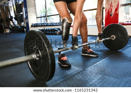 Cropped image of fitness disabled invalid woman wearing prosthes Stock photo © deandrobot