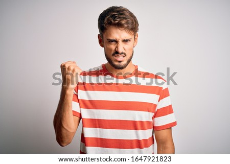 Emotional furious man in striped t-shirt screaming and showing f Stock photo © deandrobot