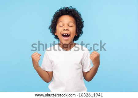 Portrait of excited african american boy screaming and grabbing  Stock photo © deandrobot