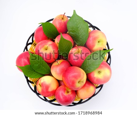 Pink lady royal gala red and granny smith green apples in vintage basket on wooden background.  Stock photo © DenisMArt