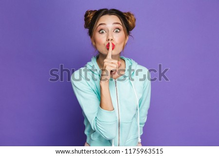 Portrait of caucasian woman with two buns holding index finger o Stock photo © deandrobot