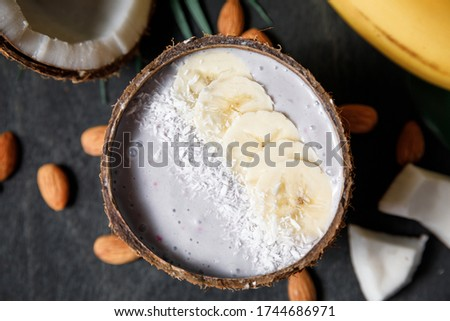 Chia seed pudding with almond milk and fresh mango topping with levitating spoon Stock photo © galitskaya