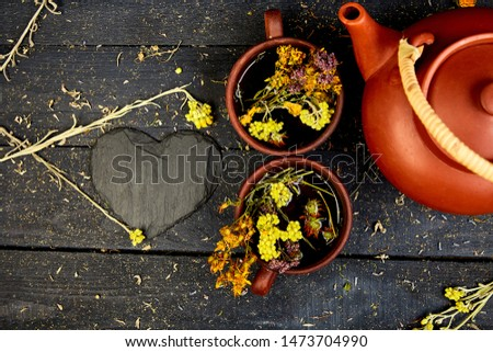 Cup of herbal tea - tutsan, sagebrush, oregano, helichrysum, lavender Stock photo © Illia