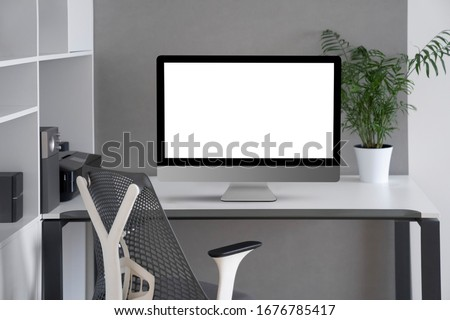 Stock photo: Modern office interior with orthopaedic chair, comfortable desk, new laptop and office equipment on