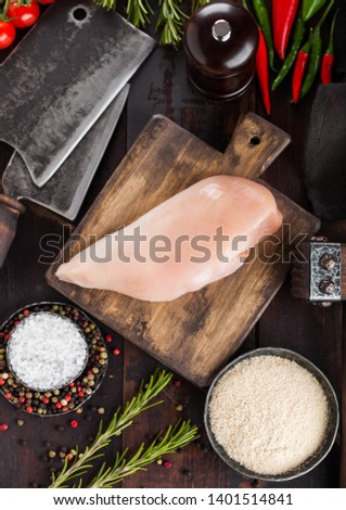 Fresh Raw Organic Chicken Fillet Breast on vintage wooden board with meat hatchet and spices with he Stock photo © DenisMArt