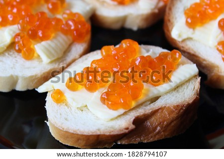 Delicious fish rolls and canape with red caviar served on plates. Stock photo © studiolucky