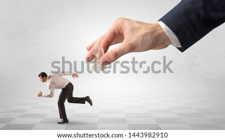 Small businessman running away from big hand with chessman concept Stock photo © ra2studio