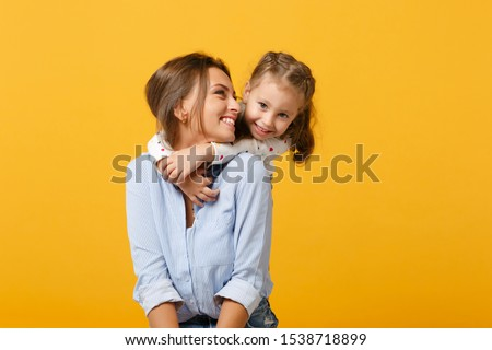 happy mother and daughter child together with yellow dandelion flowers in summer day stock photo © elenabatkova