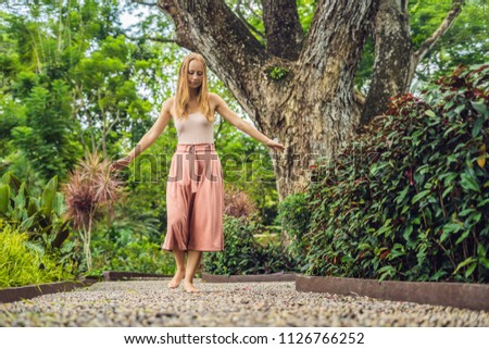 Woman Walking On A Textured Cobble Pavement, Reflexology. Pebble stones on the pavement for foot ref Stock photo © galitskaya