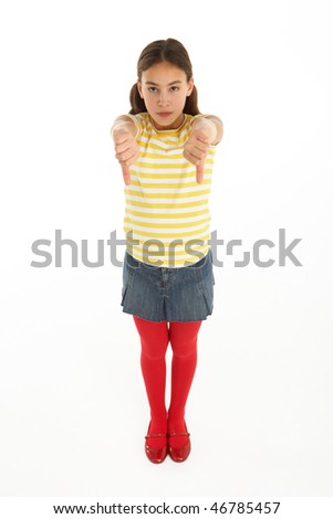 studio portrait of defiant young girl giving thumbs down gesture stock photo © monkey_business