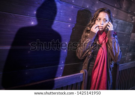 Frightened Young Adult Woman Walking As Mysterious Male Shadow F Stock photo © feverpitch