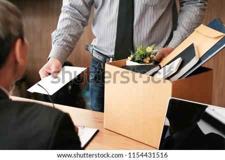 üzletember · kéz · küldés · lemondás · levél · igazgató - stock fotó © freedomz