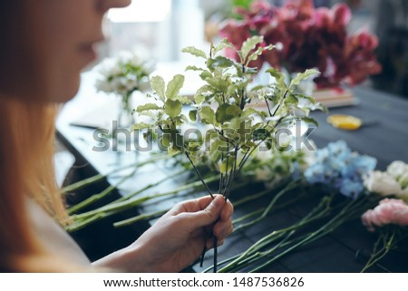 Adding greenery into bouquet for texture Stock photo © pressmaster
