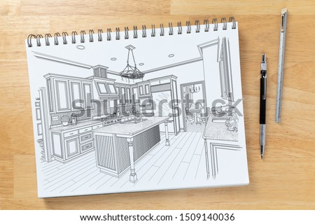 Sketch Pad on Desk Top with Drawing of Custom Kitchen Interior N Stock photo © feverpitch