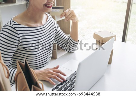 Happy Woman using smart phone and credit card register payments  Stock photo © Freedomz