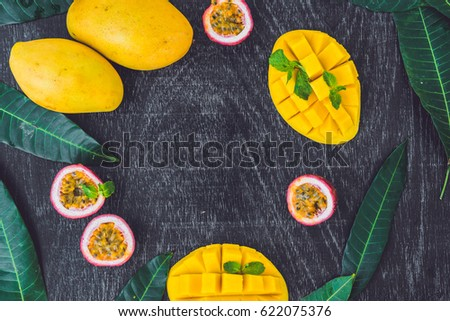 mango and passion fruit on an old wooden background copy space foto stock © galitskaya