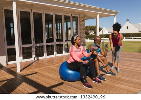 Front view of young fit African American female personal trainer training senior African American co Stock photo © wavebreak_media