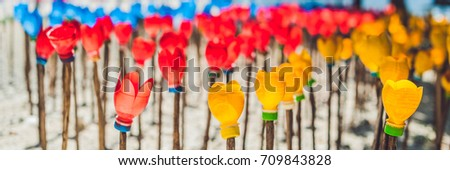 BANNER Flowers made from a plastic bottle. plastic bottle recycled. Waste recycling concept Long For Stock photo © galitskaya