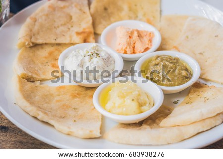 pieces of pita bread and four kinds of greek sauces greek food concept stock photo © galitskaya