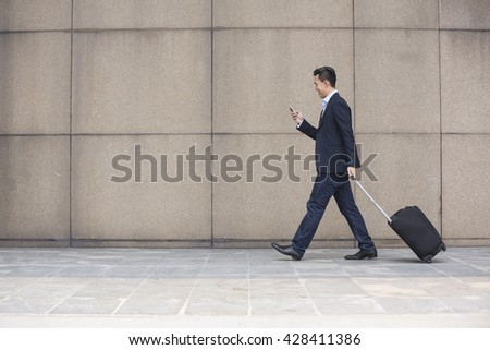 side view of casually dressed young asian male executive using laptop in modern office stock photo © wavebreak_media