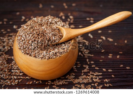 Raw natural organic linseed flax-seed in wooden spoon on wooden background. Stock photo © DenisMArt