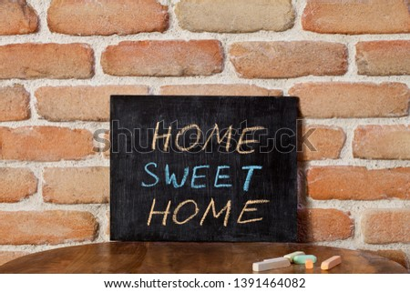 Black chalkboard with the phrase HOME SWEET HOME drown by hand o Stock photo © marylooo