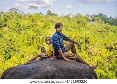 Dad and son tourists on a stone over the jungle. Traveling with kids concept. What to do with childr Stock photo © galitskaya