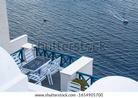 Santorini Greece Home Patio With Ocean View As Cruise Ship Tende Stock photo © feverpitch